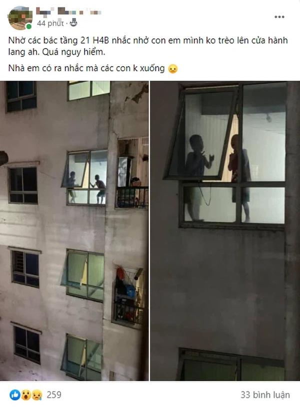 Thót tim cảnh 2 bé trai trèo ra cửa hành lang chung cư cao tầng chơi đùa chênh vênh trên gờ tường: Phụ huynh cần cảnh giác-1